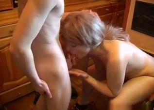 Leggy mommy fucks her son in the kitchen