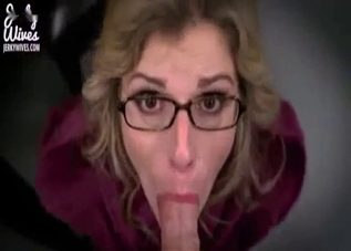 Glasses-wearing blonde mommy jerks him off