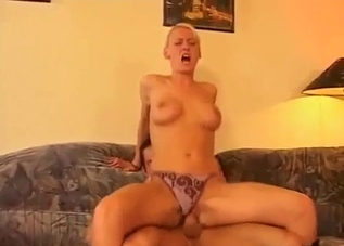 Short-haired blonde swapping spit with her son