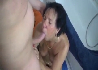 Tanned mommy rides son's cock on the floor