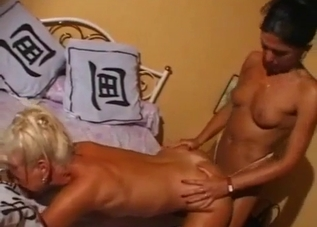 Tanned mother and tanned daughter lick each other